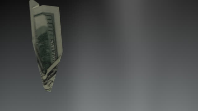 Dollar bill plane falls down concept - loopable video