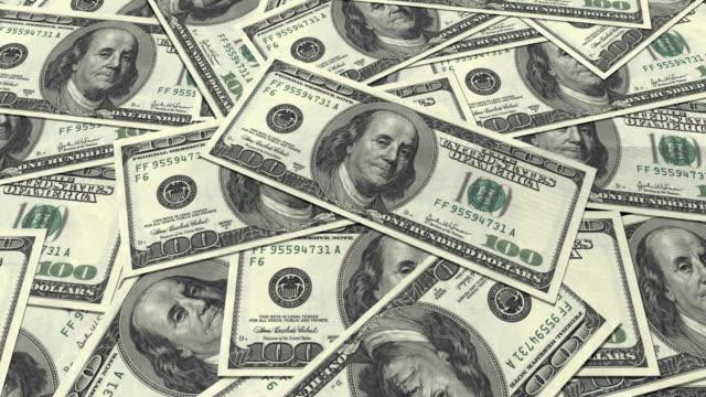 dollar bills. 4k quad ultra hd background video. - avidità video stock e b–roll