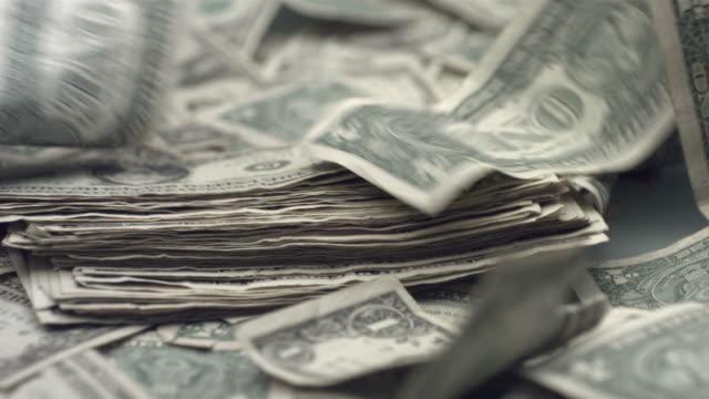 Dollar bills blowing away, slow motion