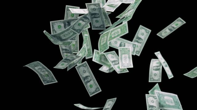 SLO MO Dollar bills falling down on black background