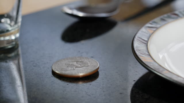 Dollar Coin Levitating On A Dining Table video