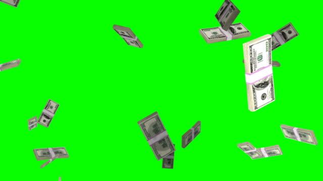 us-dollar-stack fliegt in zeitlupe gegen green screen - viele gegenstände stock-videos und b-roll-filmmaterial