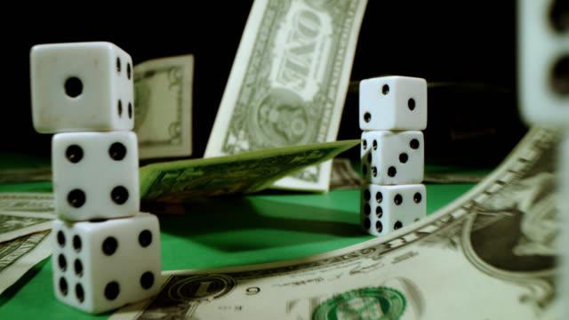 SLO MO Dollars falling on a gambling table