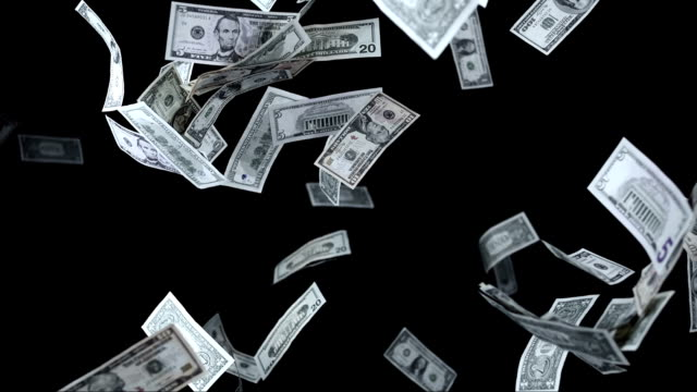dollars falling over black background (super slow motion) - money stok videoları ve detay görüntü çekimi