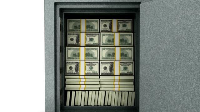 долларов в сейф.  закрывать двери.  уменьшение изображения. - dollar bill стоковые видео и кадры b-roll