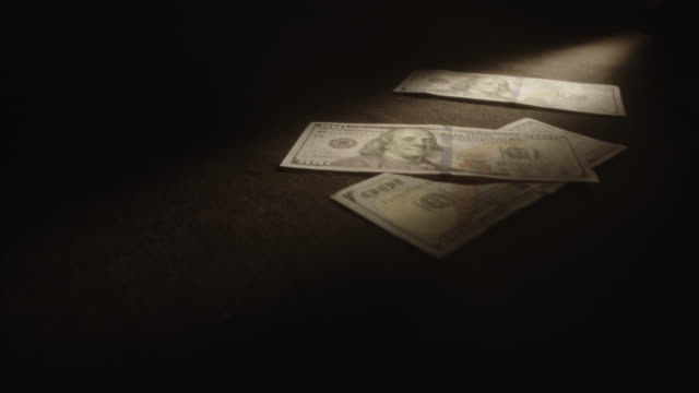 U.S. Dollars Tossed Onto Table, Net Filter, Shallow Focus