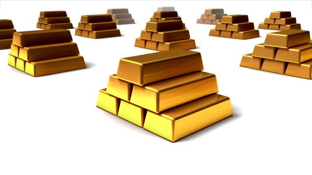 Dolly back diagonally a stack of Gold Ingots revealing many video