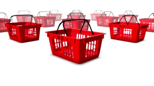 Dolly back diagonally from single Shopping Basket revealing many Baskets video
