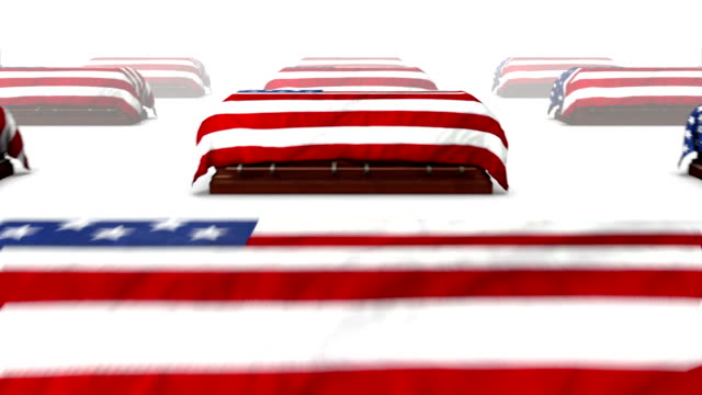 Dolly back revealing many American Coffins video