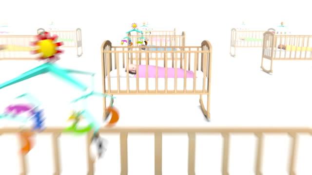 vídeos de stock, filmes e b-roll de dolly costas revelam muitos bebê de berço - mobile