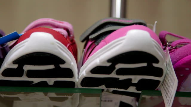 Dolly: Children and kids shoes in a shoe store video