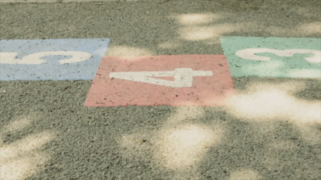Dolly: deserted school yard with hopscotch marks video