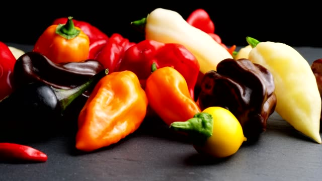 Dolly: different Chili peppers on black Macro Dolly shot kg different Chili peppers in Klack background chili pepper stock videos & royalty-free footage