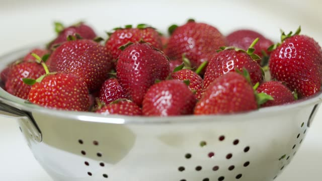 Dolly: Fresh ripe strawberry in a colander close-up. video