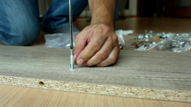 Dolly: furniture assembly dolly shot, screw furniture assembly workbench stock videos & royalty-free footage