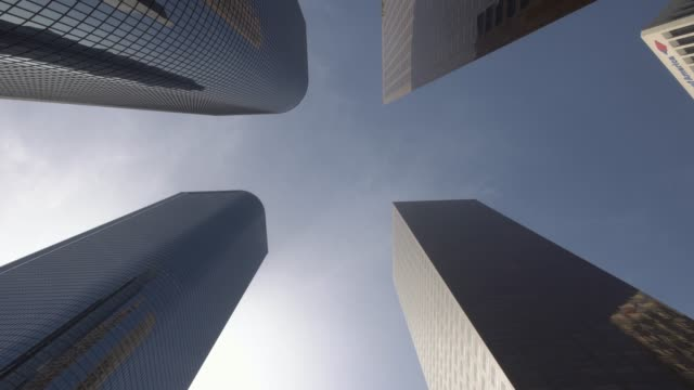 Dolly gliding looking up view of modern skyscrapers in Los Angeles city financial district Low angle moving dolly shot of downtown Los Angeles LA city buildings on a sunny california day low angle view stock videos & royalty-free footage