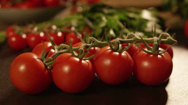 4K Dolly Move - Close-Up of a kitchen with fresh tomatoes and vegetables