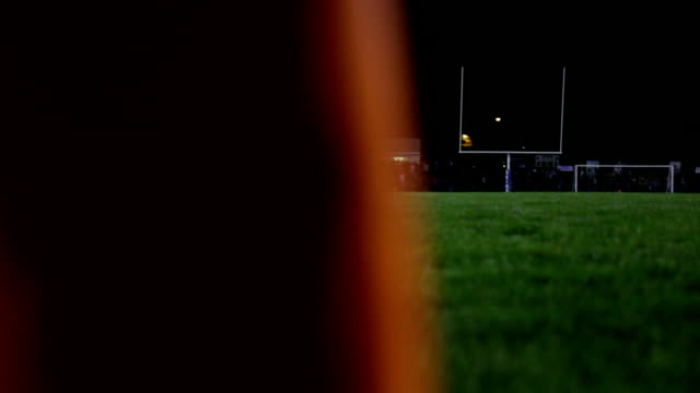 dolly of a football field revealed behind a pylon dolly of a football field revealed behind a pylon high school sports stock videos & royalty-free footage