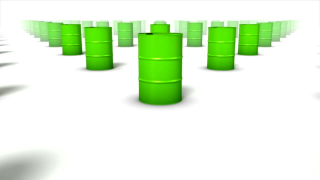 Dolly over many Oil Drums to a single Drum (Green) video