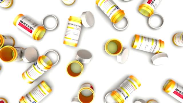 dolly over the top of many empty pill bottles - amfetamin pills bildbanksvideor och videomaterial från bakom kulisserna