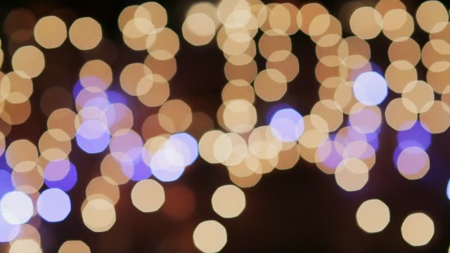 Dolly panning shot of defocused Christmas lights background. Holiday backgrounds Dolly panning shot of defocused Christmas lights background. Holiday backgrounds navidad stock videos & royalty-free footage