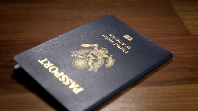 dolly parallax shot of usa passport, shallow dof - passports and visas stock videos and b-roll footage