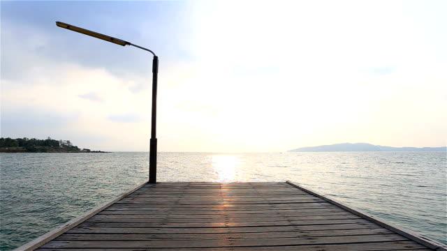 HD Dolly: Seaside wooden bridge in the morning. video