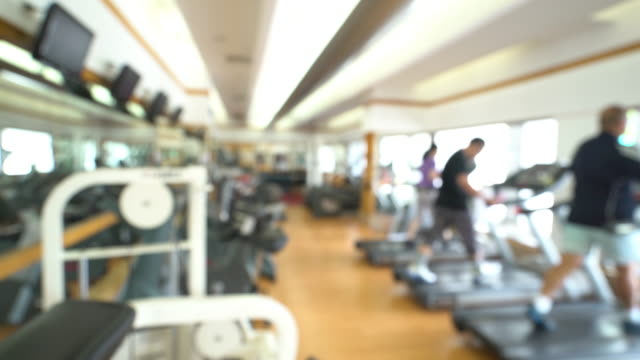 Dolly Shot: Abstract blurred background: fitness center gym club video