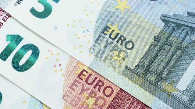 Dolly shot across a set of Euro notes