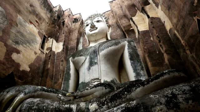Dolly shot: Big buddha in Sukhothai historical park Thailand Dolly shot: Big buddha in Sukhothai historical park Thailand, High Definition sukhothai stock videos & royalty-free footage