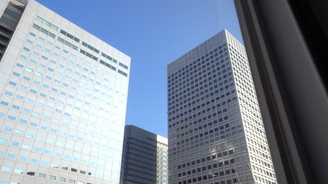 ドリー ショット: 建物東京の街並 - 建物点の映像素材/bロール