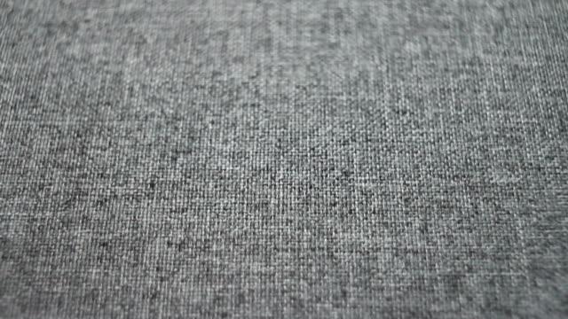 多莉射擊。相機滑過質感的灰色亞麻帆布織物 - fabric texture 個影片檔及 b 捲影像