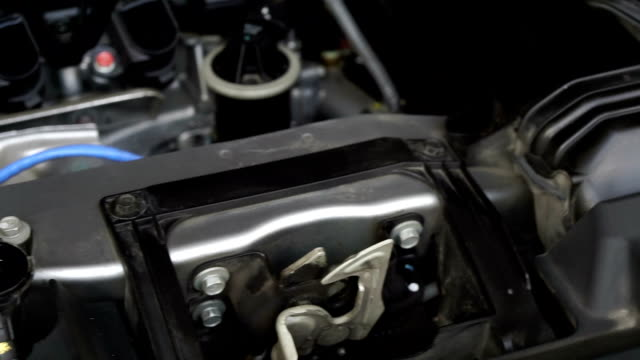 Dolly shot checking the coolant level in the car radiator. video