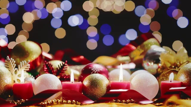 Dolly shot Christmas decoration on table with lights and candles. Holiday backgrounds Dolly shot Christmas decoration on table with lights and candles. Holiday backgrounds navidad stock videos & royalty-free footage