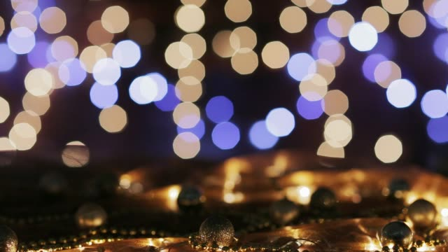 Dolly shot Christmas lights on table with and defocused lights at the background. Holiday backgrounds Dolly shot Christmas lights on table with and defocused lights at the background. Holiday backgrounds navidad stock videos & royalty-free footage