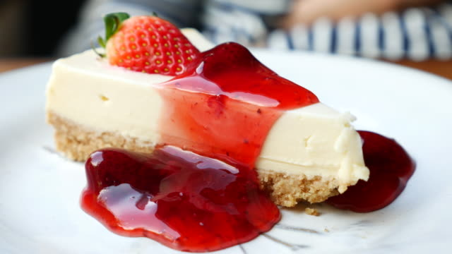 Dolly shot: Delicious homemade cheesecake with strawberries jam video
