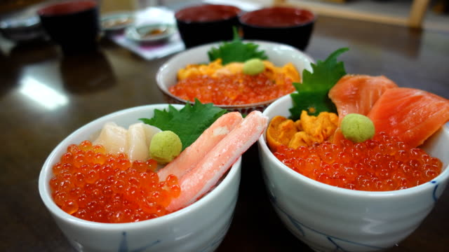 dolly shot donburi japanese food rice with raw fish - sashimi video stock e b–roll