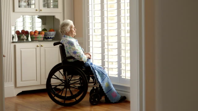stockvideo's en b-roll-footage met dolly shot elderly person in a wheelchair - eenzaamheid