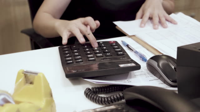 Dolly Shot Of Asian Woman Calculating In Home video