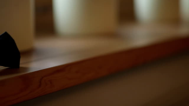Dolly Shot Of Bowtie On Wooden Table video