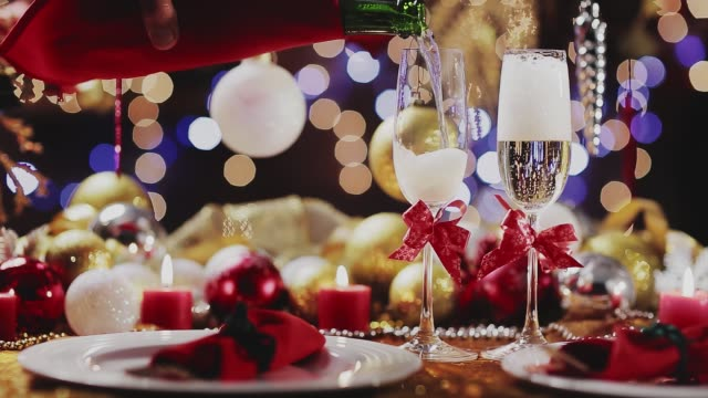 Dolly shot of Champagne pouring and spilling over flute with golden holiday background. Christmas and New Year celebration Dolly shot of  Champagne pouring and spilling over flute with golden holiday background. Christmas and New Year celebration navidad stock videos & royalty-free footage