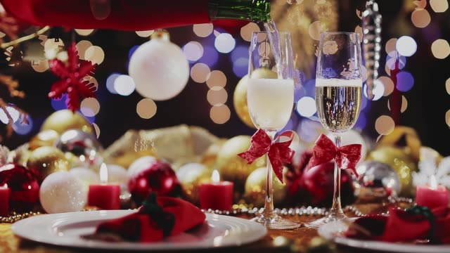 Dolly shot of Champagne pouring in flute over golden holiday background. Christmas and New Year celebration Dolly shot of  Champagne pouring in flute over golden holiday background. Christmas and New Year celebration navidad stock videos & royalty-free footage