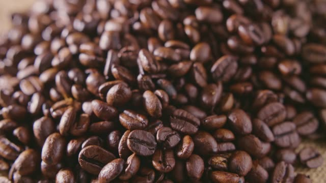 Dolly Shot Of Coffee Beans On Hessian Sack 4K video