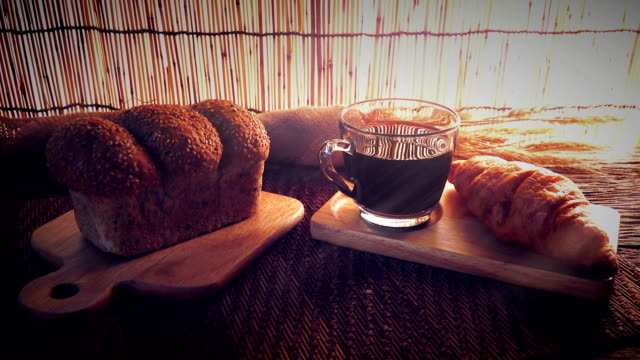 dolly shot of cup of coffee with bread. - french food stock videos and b-roll footage