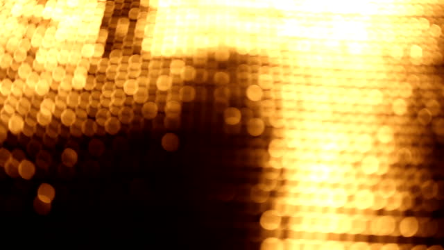 Dolly shot of golden bokeh background video