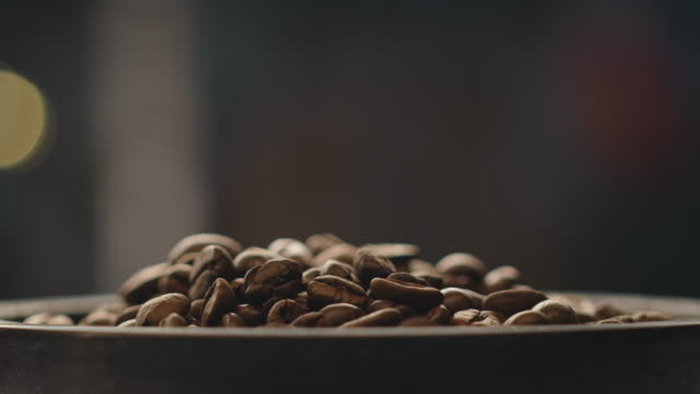 Dolly shot of roasted coffee beans at factory