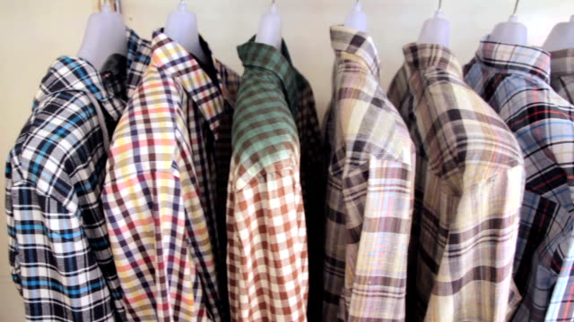 Dolly Shot of Shirts on a coat rack video