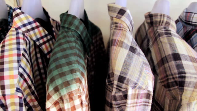 Dolly Shot of Shirts on a coat rack,Close up video