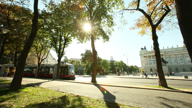 Dolly shot of  tram through the trees on Vienna boulevard video