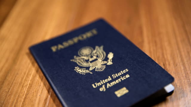 cu dolly shot of usa passport, shallow dof - passports and visas stock videos and b-roll footage